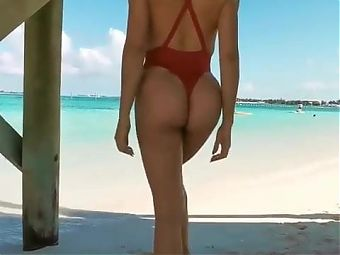 Daniella Chavez with red g-string swimwear